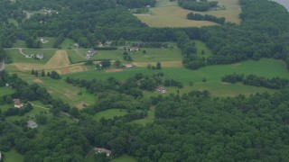 AX78_056 - 5K stock footage aerial video flying by rural homes in Brookeville, Maryland