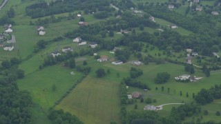 AX78_057 - 5K stock footage aerial video or rural homes and barns in Brookeville, Maryland
