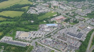 AX78_060 - 5K stock footage aerial video tilting from State Route 32 to reveal car dealerships, stores, and suburban homes in Clarksville, Maryland