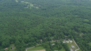 AX78_063 - 5K stock footage aerial video flying over forest to approach Hobbit's Glen Golf Course in Columbia, Maryland