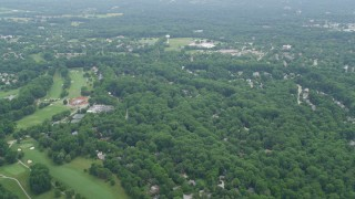 AX78_064 - 5K stock footage aerial video flying over Hobbit's Glen Golf Course and suburban homes in Columbia, Maryland