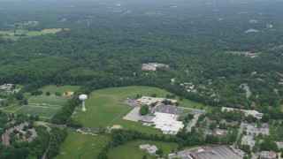 AX78_066 - 5K stock footage aerial video flying over schools and suburban homes in Columbia, Maryland