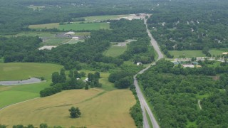 AX78_068 - 5K stock footage aerial video of farm fields by Centennial Lane in Ellicott City, Maryland
