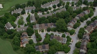 AX78_069 - 5K stock footage aerial video approaching town houses on Fairway Hills Golf Course in Columbia, Maryland