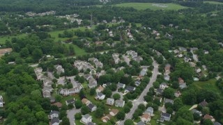 AX78_072 - 5K stock footage aerial video flying over suburban neighborhoods in Ellicott City, Maryland