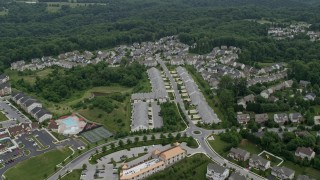 AX78_074 - 5K stock footage aerial video of town homes and forest in Ellicott City, Maryland
