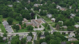 AX78_077 - 5K stock footage aerial video of Catonsville Presbyterian Church and residential neighborhoods, Maryland