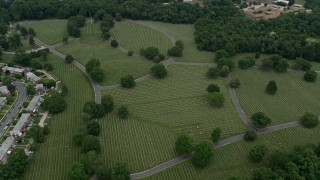 AX78_080 - 5K stock footage aerial video of Baltimore National Cemetery in Catonsville, Maryland