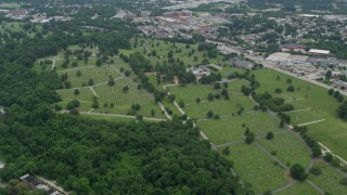 AX78_081 - 5K stock footage aerial video of Loudon Park Funeral Home and Cemetery in Baltimore, Maryland