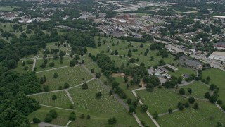 AX78_081E - 5K stock footage aerial video of Loudon Park Funeral Home and Cemetery in Baltimore, Maryland