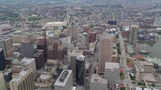 AX78_088 - 5K stock footage aerial video flying over Downtown Baltimore skyscrapers, Maryland