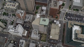 AX78_089 - 5K stock footage aerial video of bird's eye view of city streets and office buildings in Downtown Baltimore, Maryland
