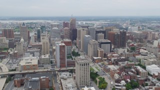 AX78_095 - 5K stock footage aerial video flying by Downtown Baltimore skyscrapers, Maryland