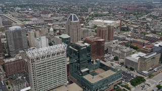 AX78_100 - 5K stock footage aerial video of 100 East Pratt Street building, and The Gallery Mall and office tower in Baltimore, Maryland