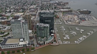 AX78_101 - 5K stock footage aerial video approaching Marriott and Four Seasons hotels, Legg Mason Tower, and Harbor East Marina in Baltimore, Maryland