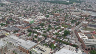 AX78_102 - 5K stock footage aerial video of shops and apartment buildings beside Broadway in Baltimore, Maryland