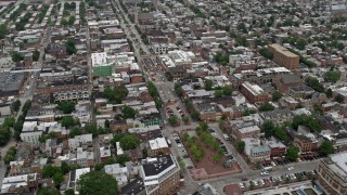 AX78_102E - 5K stock footage aerial video of shops and apartment buildings beside Broadway in Baltimore, Maryland