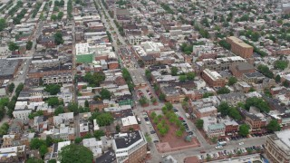 AX78_103 - 5K stock footage aerial video of shops and apartment buildings around Broadway and Broadway Square in Baltimore, Maryland