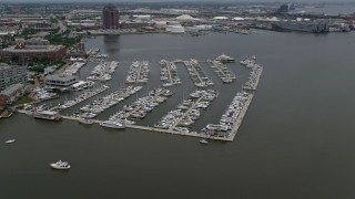 AX78_104 - 5K stock footage aerial video of boats at the Baltimore Marine Center, Maryland