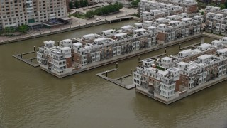 AX78_112 - 5K stock footage aerial video of Waterfront Pier Homes At HarborView condos in Baltimore, Maryland
