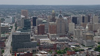 AX78_114E - 5K stock footage aerial video flying by skyscrapers and city buildings in Downtown Baltimore, Maryland