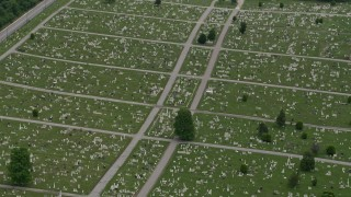 AX78_120 - 5K stock footage aerial video of gravestones and green lawns at Baltimore Cemetery in Maryland