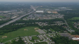 AX78_128 - 5K stock footage aerial video approaching office buildings, light traffic on Interstate 95, and apartment buildings in Baltimore, Maryland