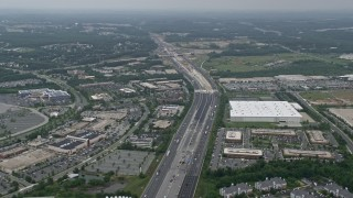 AX78_128E - 5K stock footage aerial video approaching office buildings, light traffic on Interstate 95, and apartment buildings in Baltimore, Maryland