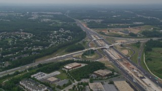AX78_131 - 5K stock footage aerial video flying over office buildings by I-95 to approach suburban neighborhoods in Baltimore, Maryland