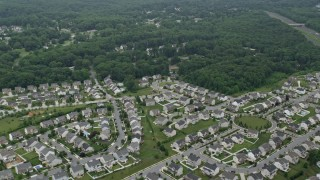 AX78_133E - 5K stock footage aerial video flying over a suburban neighborhood in Perry Hall, Maryland