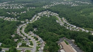 AX78_144 - 5K stock footage aerial video flying over suburban houses by Abingdon Fire Company in Abigdon, Maryland