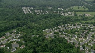 AX78_145 - 5K stock footage aerial video flying over tract homes and trees in Abigdon, Maryland