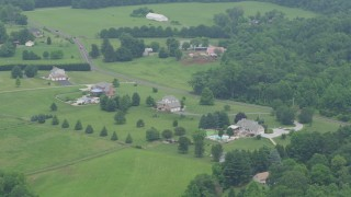 AX78_147 - 5K stock footage aerial video of rural homes and a farm by Cullum Road in Abigdon, Maryland