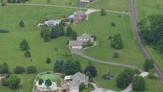 AX78_148 - 5K stock footage aerial video of rural homes by a country road in Abigdon, Maryland