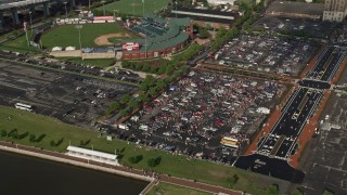 AX79_003 - 5K stock footage aerial video of tailgating at parking lot by Campbell's Field, Camden, New Jersey