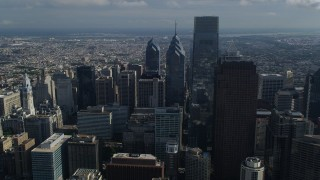 AX79_012 - 5K stock footage aerial video of Comcast Center towering over Downtown Philadelphia skyscrapers, Pennsylvania