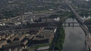 AX79_028 - 5K stock footage aerial video of Veolia Energy power plant next to the Schuylkill River Philadelphia, Pennsylvania