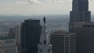 AX79_038 - 5K stock footage aerial video approaching William Penn statue on Philadelphia City Hall, Downtown Philadelphia, Pennsylvania