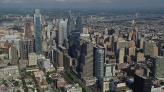AX79_053 - 5K stock footage aerial video flying by and approaching skyscrapers in Downtown Philadelphia, Pennsylvania