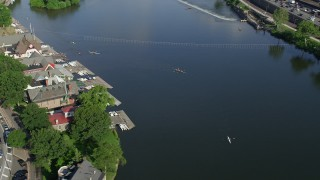 AX79_063 - 5K stock footage aerial video of rowers on the Schuylkill River by Boathouse Row, Philadelphia, Pennsylvania