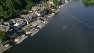 AX79_064 - 5K stock footage aerial video of rowers by Boathouse Row along Schuylkill River, Philadelphia, Pennsylvania