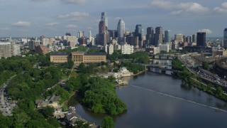 AX79_067 - 5K stock footage aerial video of Philadelphia Museum of Art, Fairmount Water Works, and skyline of Downtown Philadelphia, Pennsylvania