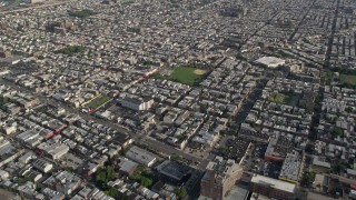 AX79_074 - 5K stock footage aerial video of baseball field and urban homes, South Philadelphia, Pennsylvania