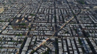 AX79_075 - 5K stock footage aerial video following S 12th Street through urban neighborhoods in South Philadelphia, Pennsylvania