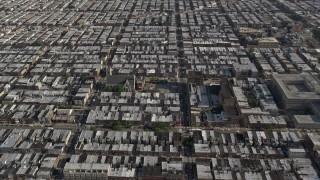AX79_075E - 5K stock footage aerial video following S 12th Street through urban neighborhoods in South Philadelphia, reveal sports fields, Pennsylvania