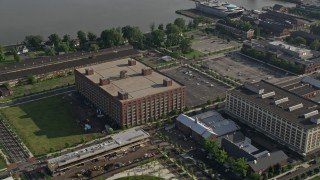 AX79_081 - 5K stock footage aerial video of a factory building at The Navy Yard in Philadelphia, Pennsylvania