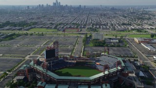 AX79_083 - 5K stock footage aerial video flying over Citizens Bank Park to approach South Philly urban neighborhoods and skyline, Philadelphia, Pennsylvania