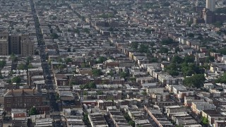 AX79_085 - 5K stock footage aerial video of urban neighborhoods and S 7th Street in South Philadelphia, Pennsylvania