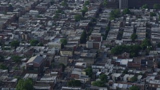 AX79_086 - 5K stock footage aerial video of urban neighborhood and busy street in South Philadelphia, Pennsylvania