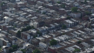 AX79_087 - 5K stock footage aerial video of an urban neighborhood in South Philadelphia, Pennsylvania